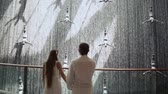 admirado : DUBAI, UAE - AUGUST 20, 2014: Young couple admired Waterfall in Dubai Mall