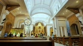 intramuros : KALIBO, PHILIPPINES - JANUARY 5, 2018: Interior inside the Catholic temple in the Philippines. Parishioners and tourists near the Christmas nativity scene. Prayers. Excursions.