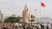 motorcyclists : NHA TRANG, VIETNAM - OCTOBER 1, 2016: City transport in motion. Infrastructure of the city. A tower called the Lotus Flower in Nha Trang City. Vietnam.