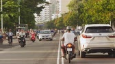 motorcyclists : NHA TRANG, VIETNAM - OCTOBER 1, 2016: Urban transport in the daytime. The movement of motorcyclists. Infrastructure of the city. Nha Trang. Vietnam.
