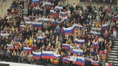 hungria bandera : Minsk, Belarus - January 26, 2019: Fans waving Russian flags in the stands. European Figure Skating Championship. Archivo de Video