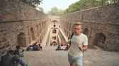 ancient tv : New Delhi, India - November 28, 2018: Russian guide talks about Agrasen ki Baoli in New Delhi.