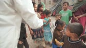 needy : Agra, India - December 12, 2018: Banana treats for children from poor areas of Agra city.