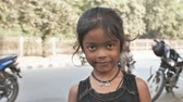 icecream : Agra, India - December 12, 2018: Portrait of a cute young Indian girl on the streets of Agra.