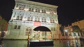 ada : Venice, Italy - August 5, 2018: Video in motion from the boat through the night channels of Venice.