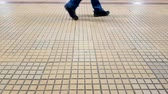 cascalho : Man feets walking on the cobblestone inside the subway station Stock Footage