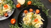 cherry rajče : Healthy homemade italian pasta in black plates with parmesan cheese on top
