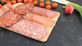 salami slice : Antipasto appetizers from sliced salami on wooden board Stock Footage