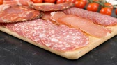 sausage slice : Delicious and healthy italian salami on wooden board