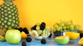 ananas : Delicious homemade fruit salad in glass bowl on yellow background. Parallax dolly footage