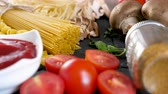 spagetti : Zoom out fresh vegetables next to pasta and tomatoe souce. Dolly slide footage Stok Video