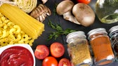 espaguete : Ingredients for dinner with pasta on dark background. Top view dolly slide footage Stock Footage