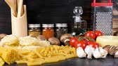 espaguete : Variety of raw pasta on table next to other ingredients for dinner on rustic wooden background