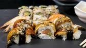 ノリ : Close up dolly slide footage of healthy and delicious sushi rolls on black stone background 動画素材