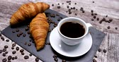 vajas : A tasty morning coffee served with two croissants. Golden crusted croissants with a cup of coffee in a beautiful breakfast composition.