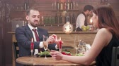 sweetheart : Bearded young man offers a diamond ring to his girlfriend. Man askes his woman to get married and offers her an engagement ring. Stock Footage