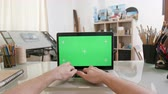webpage : Designers point of view working on a laptop with green screen on. Painters workshop. Artistic concept. Chroma key.