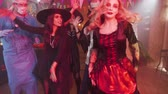 disfarçar : Group of young friends at a halloween party dancing and having fun. Dressed as different scary characters as witches, vampires, ghouls, mad surgeon and pirate Stock Footage