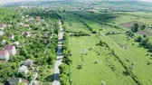 banlieue : Flying over a beautiful rural residential area. Open landscape and road with cars on it