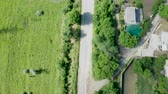 banlieue : Top down aerial view of rural road and houses. Drone footage