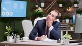week end : Tired businessman working week ends alone in the office. He is exhausted Stock Footage