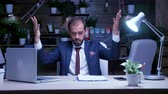 администрация : Exhausted businessman working late at night at the office. Slow motion shot