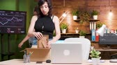 безработные : Beautiful woman getting fired from the job. She packs her belongings in a cardboard box and leaves the office