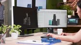 architectural model : Female architect works on new buildings render in creative media agency. Slow motion zoom in shot