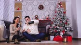 Happy caucasian couple drinking champagne in christmas decorated room