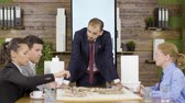 blauwdruk : Architect in business suit leaning forward the table with mini town in the conference room. Team brainstorming. Stockvideo
