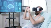 радиология : Patient in a neuroscience centre wearing vr goggle and making hand gestures. Modern neuroscience laboratory.