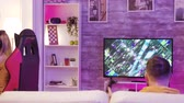 atirador : Man losing at professional online shooter game in a room with colorful neon lights. Girl playing online games sitting on gaming chair