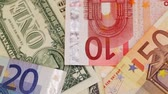 time : American dollar and European Euro cash banknotes Stock Footage