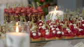karaciğer : pinchos with beetroot on a glass stand with burning candles Stok Video