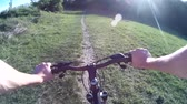 realizar : Mountain biking in a meadow. POV Original point of View