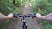realizar : Mountain biking in a forest. POV Original point of View 2