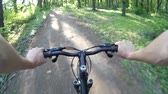 realizar : Mountain biking in a forest. POV Original point of View 3 Stock Footage