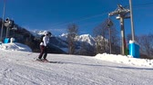 The downhill skiing. Caucasian mountains. Ski resort Rosa Khutor. Sochi. Russia.