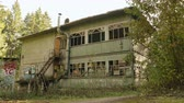 abandoned alley : Deserted house in the forest. Autumn daytime. Smooth dolly shot Stock Footage