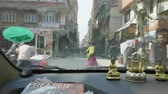 KATHMANDU, NEPAL - MARCH, 2018: View from the car on heavy traffic on the streets of the tourist area Thamel in the center of the city. Dostupné videozáznamy