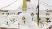 KATHMANDU, NEPAL - MARCH, 2018: Worker paints Boudhanath Stupa after earthquake in the Kathmandu valley.