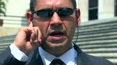 pelúcia : Man in Business Suit CIA FBI Agent Stock Footage