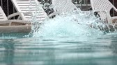 yüzme : Woman Diving into Swimming Pool