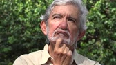 contemplando : Old Man Thinking and Pondering Stock Footage