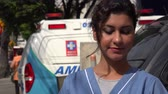 carreira : Young Hispanic Nurse and Ambulance