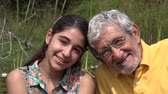 bağıl : Grandfather and Granddaughter Outdoors Stok Video
