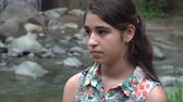 apathetic : Solemn Teenage Girl at River Stock Footage