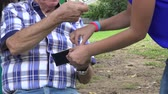 bağıl : Grandfather Giving Money to Grand Kids Stok Video