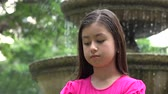 apathetic : Sad Young Girl at Park Fountain
