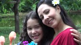 dcera : Smiling Mother and Daughter in Nature